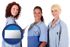 kansas three female doctors wearing hospital uniforms
