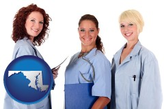 maryland three female doctors wearing hospital uniforms