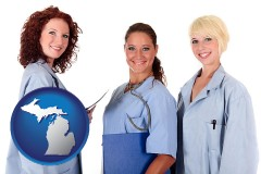 michigan three female doctors wearing hospital uniforms