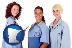 minnesota three female doctors wearing hospital uniforms