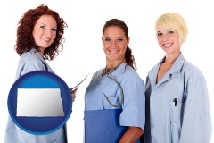 north-dakota three female doctors wearing hospital uniforms
