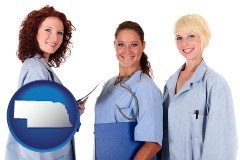 nebraska three female doctors wearing hospital uniforms