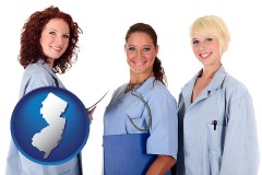 new-jersey three female doctors wearing hospital uniforms