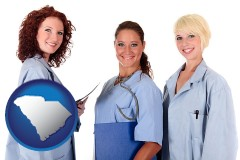 south-carolina three female doctors wearing hospital uniforms
