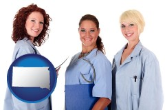 south-dakota three female doctors wearing hospital uniforms