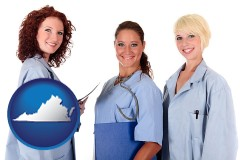 virginia three female doctors wearing hospital uniforms