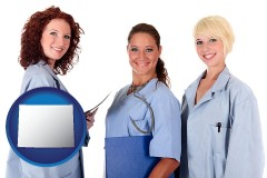 wyoming three female doctors wearing hospital uniforms