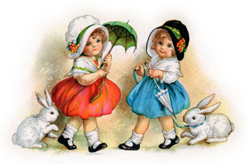two little girls wearing vintage clothing and bonnets