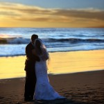 a beach wedding at sunset