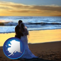 alaska map icon and a beach wedding at sunset