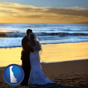 a beach wedding at sunset - with Delaware icon