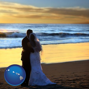 a beach wedding at sunset - with Hawaii icon