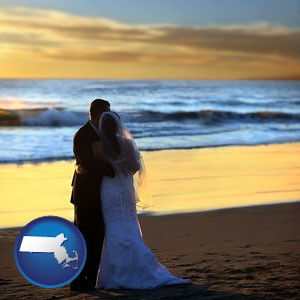 a beach wedding at sunset - with Massachusetts icon