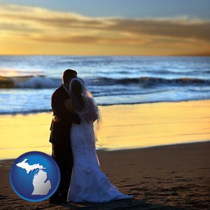a beach wedding at sunset - with Michigan icon