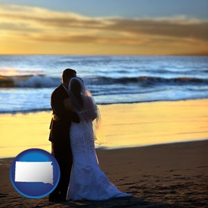 a beach wedding at sunset - with South Dakota icon