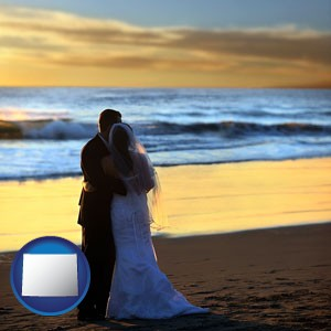 a beach wedding at sunset - with Wyoming icon