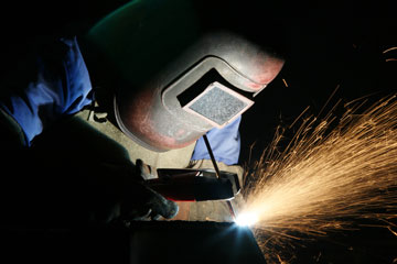 a welder using welding equipment