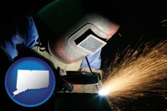 connecticut a welder using welding equipment