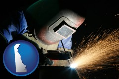 delaware map icon and a welder using welding equipment