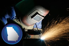 georgia map icon and a welder using welding equipment