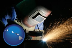 hawaii map icon and a welder using welding equipment