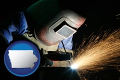 iowa map icon and a welder using welding equipment