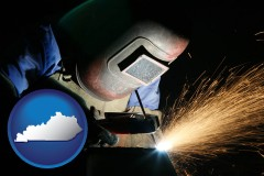 kentucky map icon and a welder using welding equipment