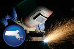 massachusetts map icon and a welder using welding equipment