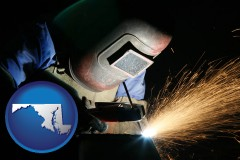 maryland map icon and a welder using welding equipment