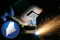 maine map icon and a welder using welding equipment