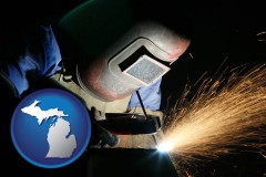 michigan map icon and a welder using welding equipment