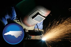 north-carolina map icon and a welder using welding equipment