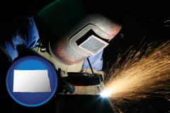 north-dakota a welder using welding equipment