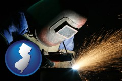 new-jersey map icon and a welder using welding equipment