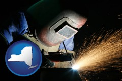 new-york map icon and a welder using welding equipment