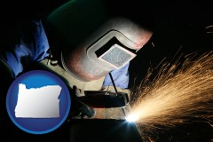 oregon a welder using welding equipment