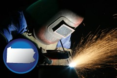 pennsylvania map icon and a welder using welding equipment