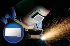 south-dakota map icon and a welder using welding equipment