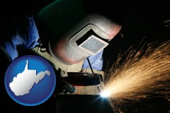 west-virginia map icon and a welder using welding equipment