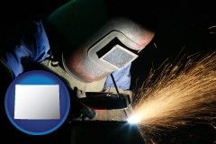 wyoming map icon and a welder using welding equipment