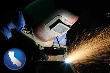 a welder using welding equipment - with California icon