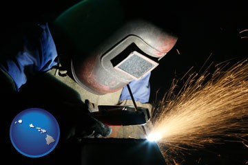 a welder using welding equipment - with Hawaii icon
