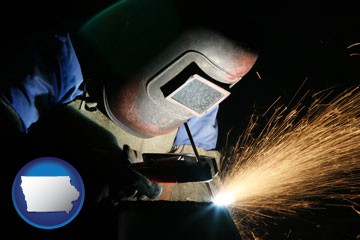 a welder using welding equipment - with Iowa icon