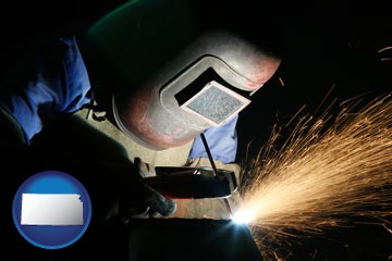 a welder using welding equipment - with Kansas icon