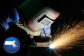 a welder using welding equipment - with Massachusetts icon