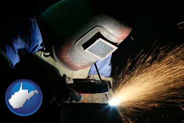a welder using welding equipment - with West Virginia icon
